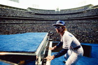 "Terry O'Neill - Elton John (playing piano) at Dodger Stadium, Los Angeles, 1975  (20"" x 24"")"